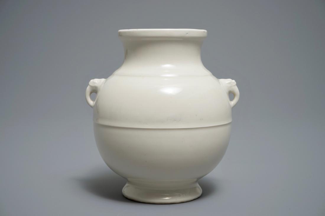 A Chinese cream-glazed hu vase with elephant handles,