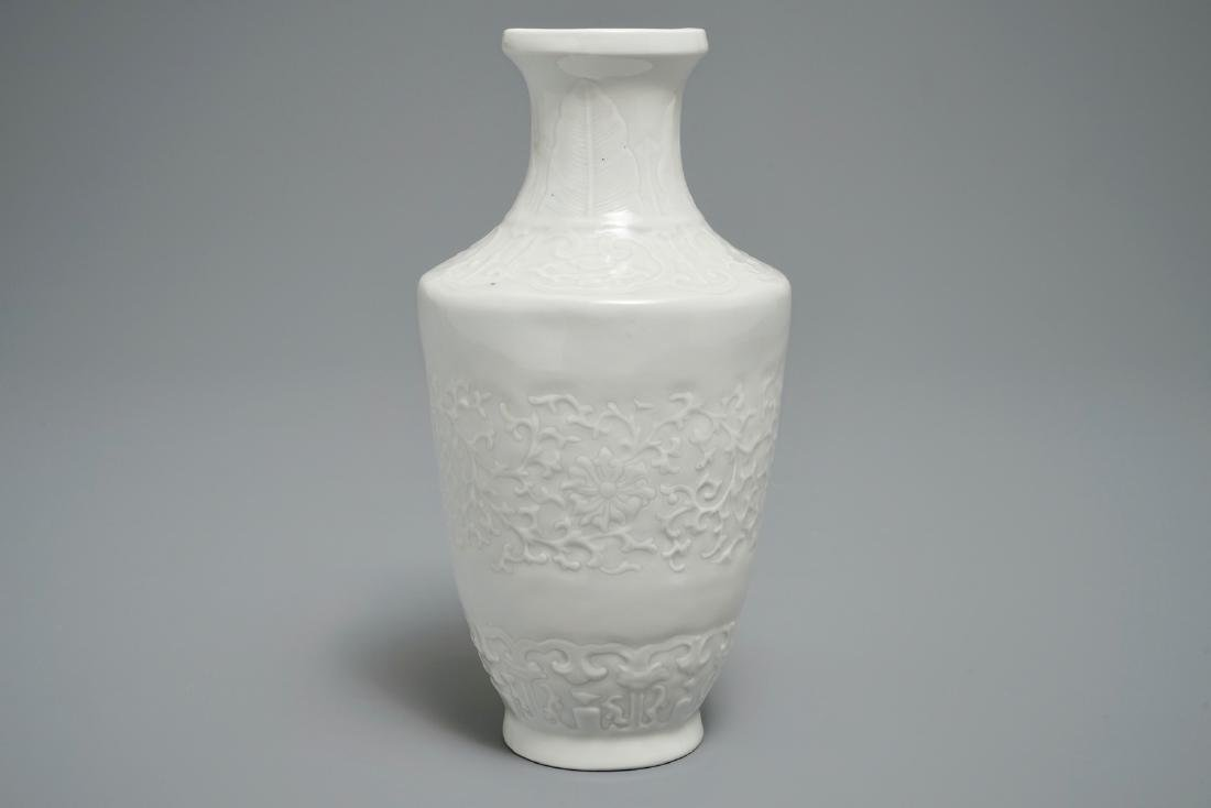 A Chinese relief-decorated blanc de Chine vase, 19/20th