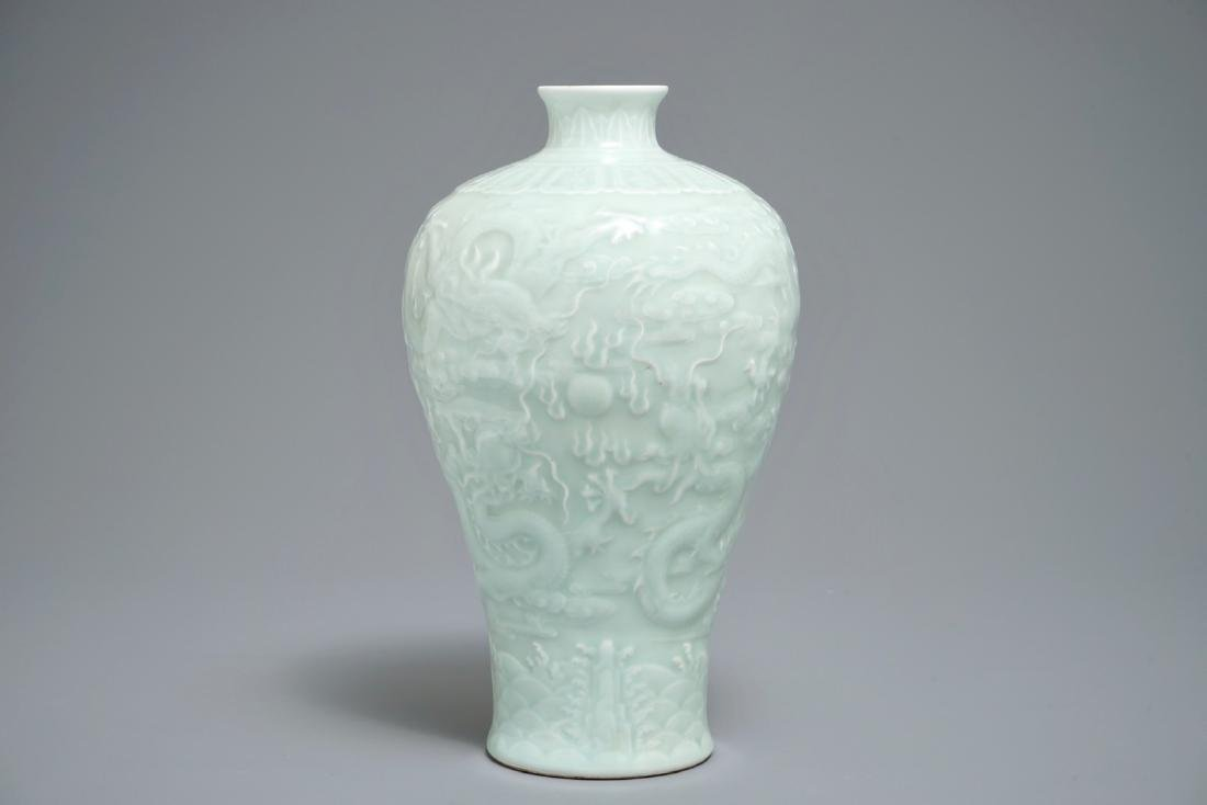 A Chinese celadon meiping vase with underglaze design