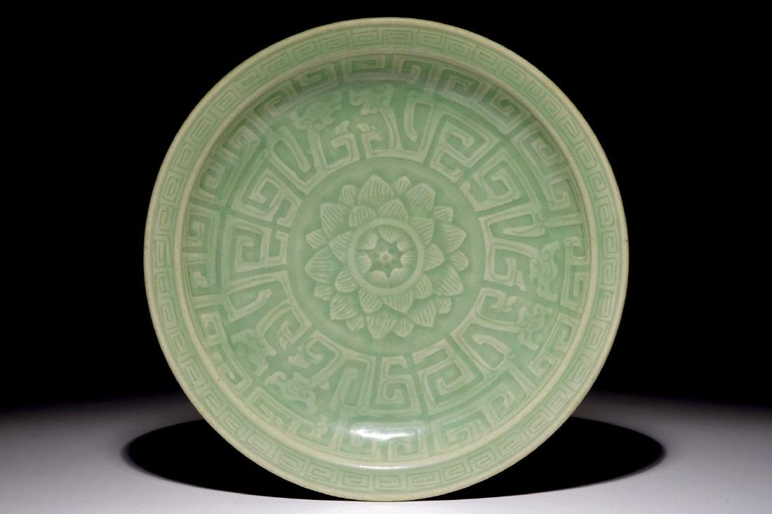 A Chinese celadon dish with incised lotus design,