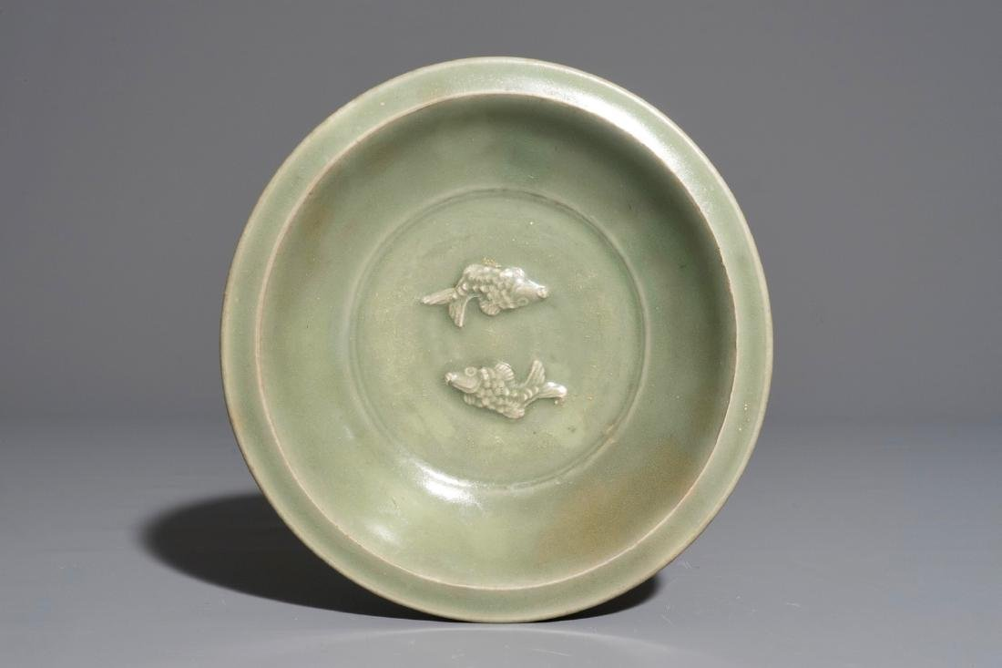 A Chinese Longquan celadon twin fish plate, Ming