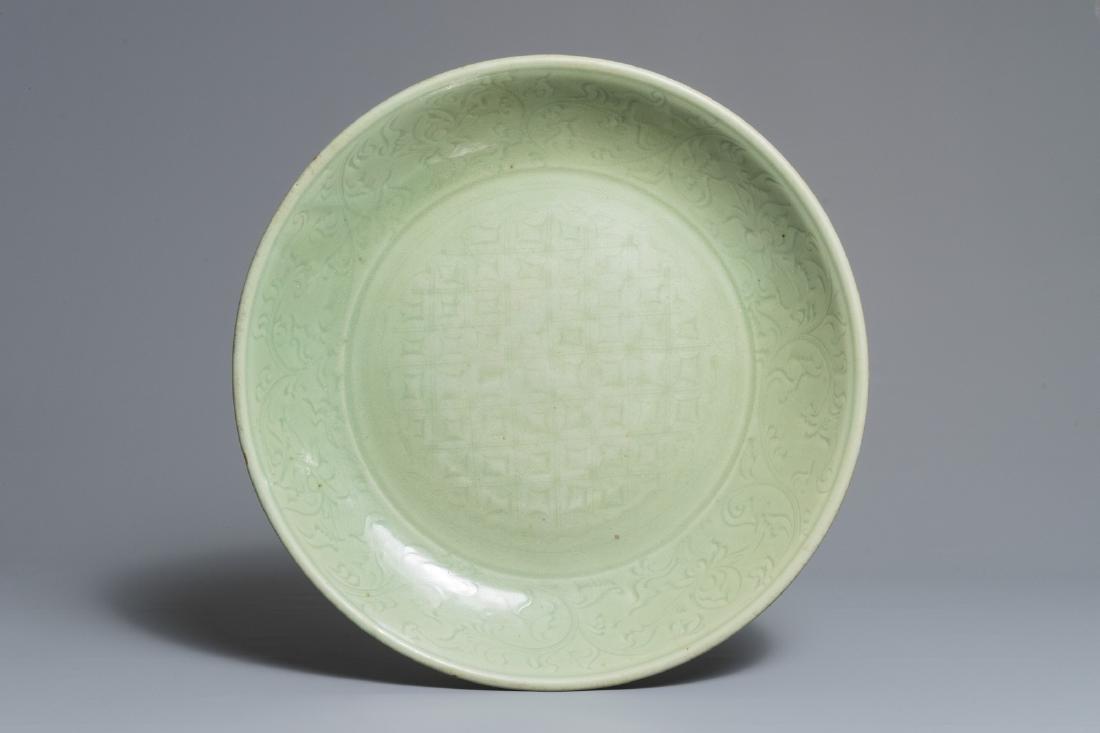 A massive Chinese Longquan celadon dish with underglaze