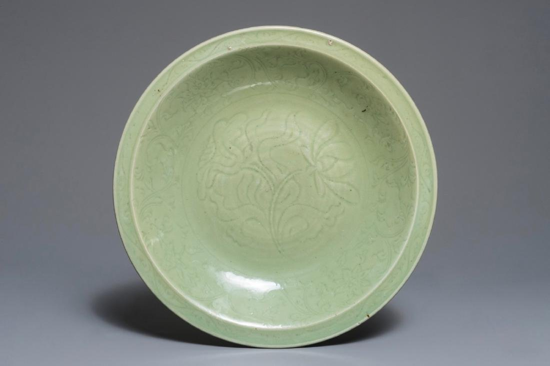 A Chinese Longquan celadon charger with underglaze