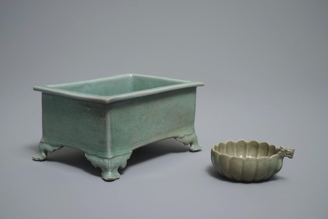 A Chinese celadon jardiniere and a Korean dragon-handle