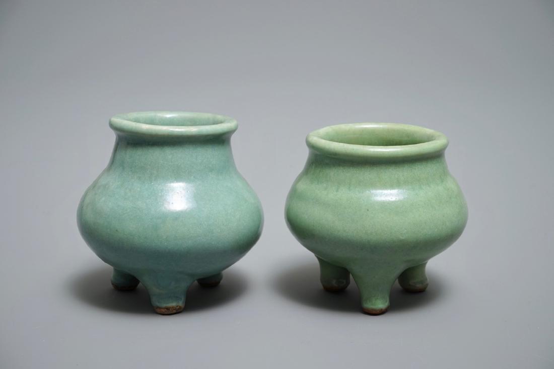 Two Chinese monochrome celadon tripod incense burners,