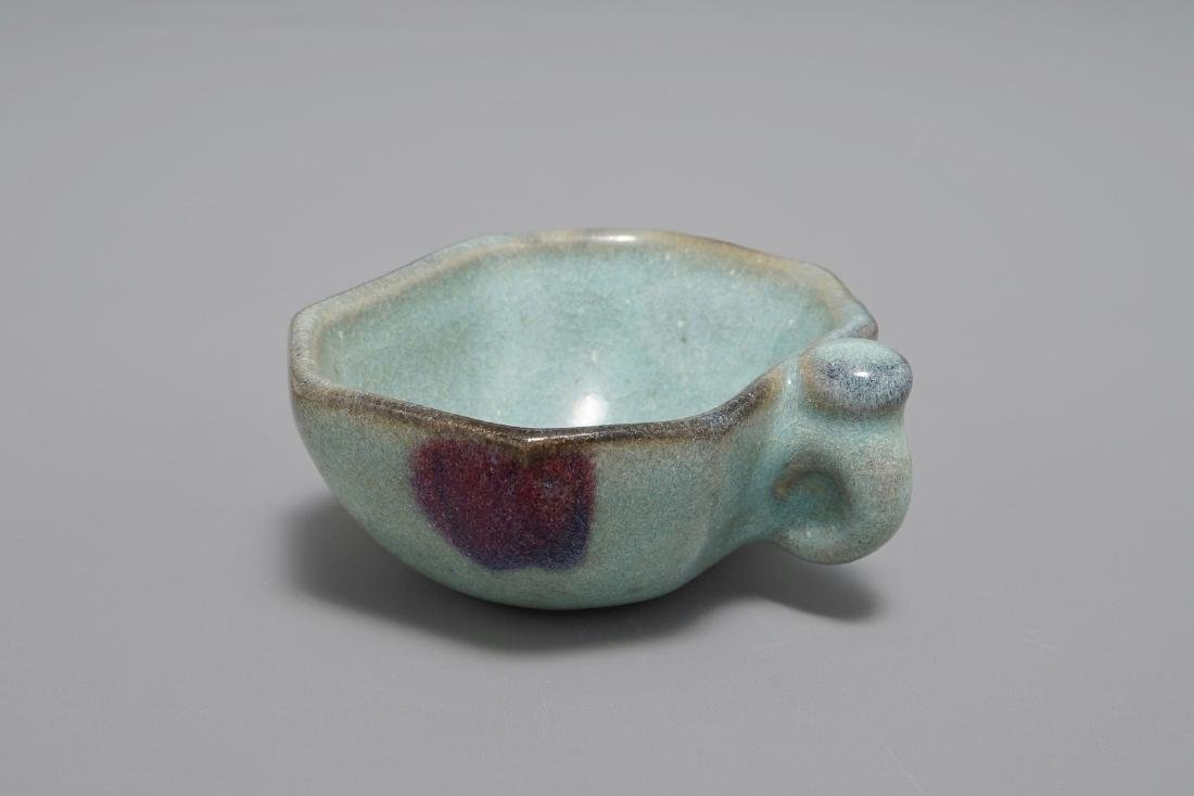 A small Chinese Junyao purple-splashed octagonal cup,