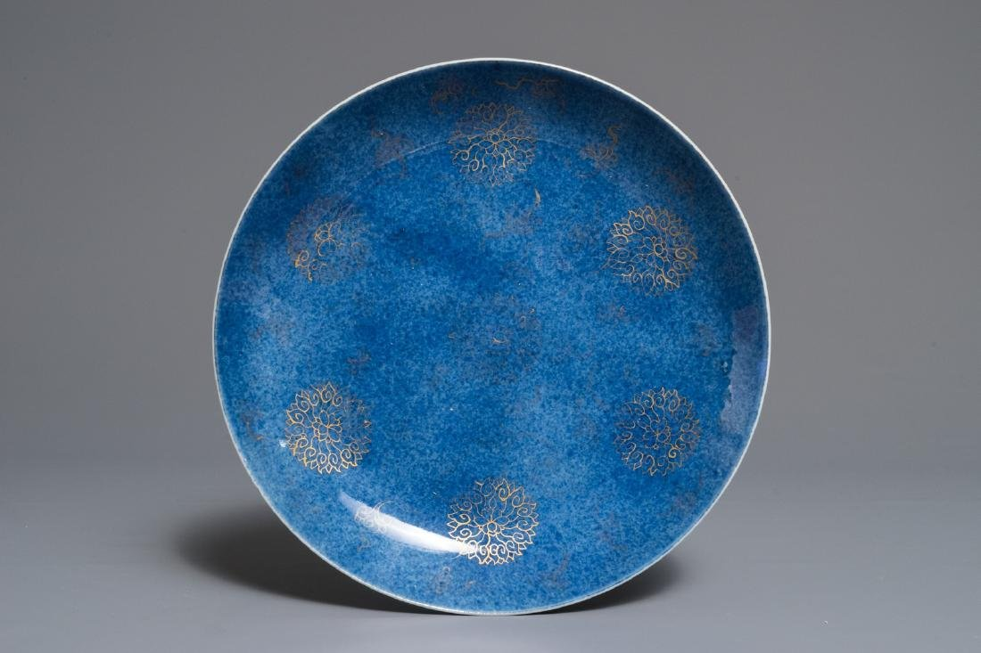 A Chinese powder blue and gilt lotus scroll dish,