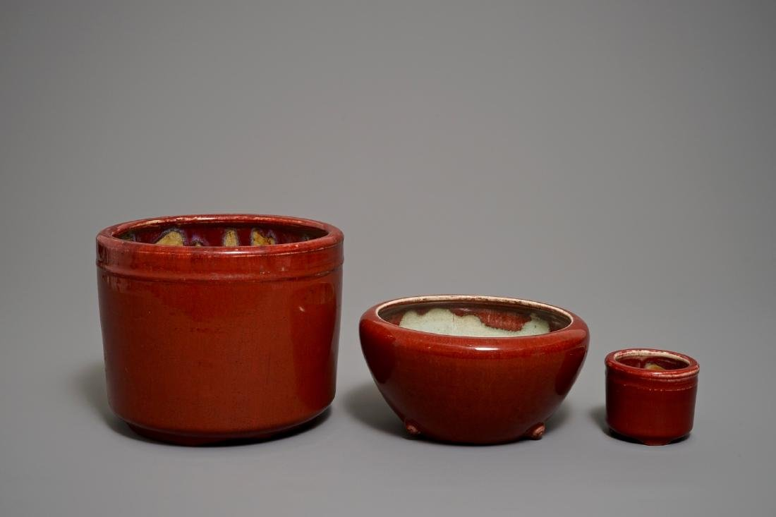 Two Chinese oxblood-glazed brush pots and an incense