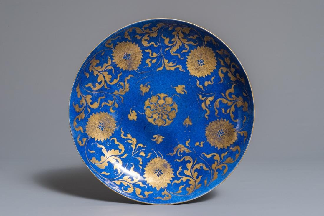 A Chinese powder blue and gilt lotus scroll plate,