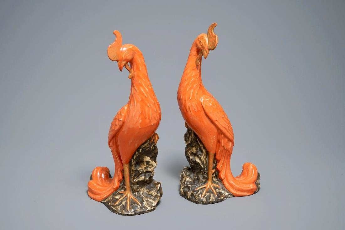 A pair of Chinese coral-ground models of phoenixes,