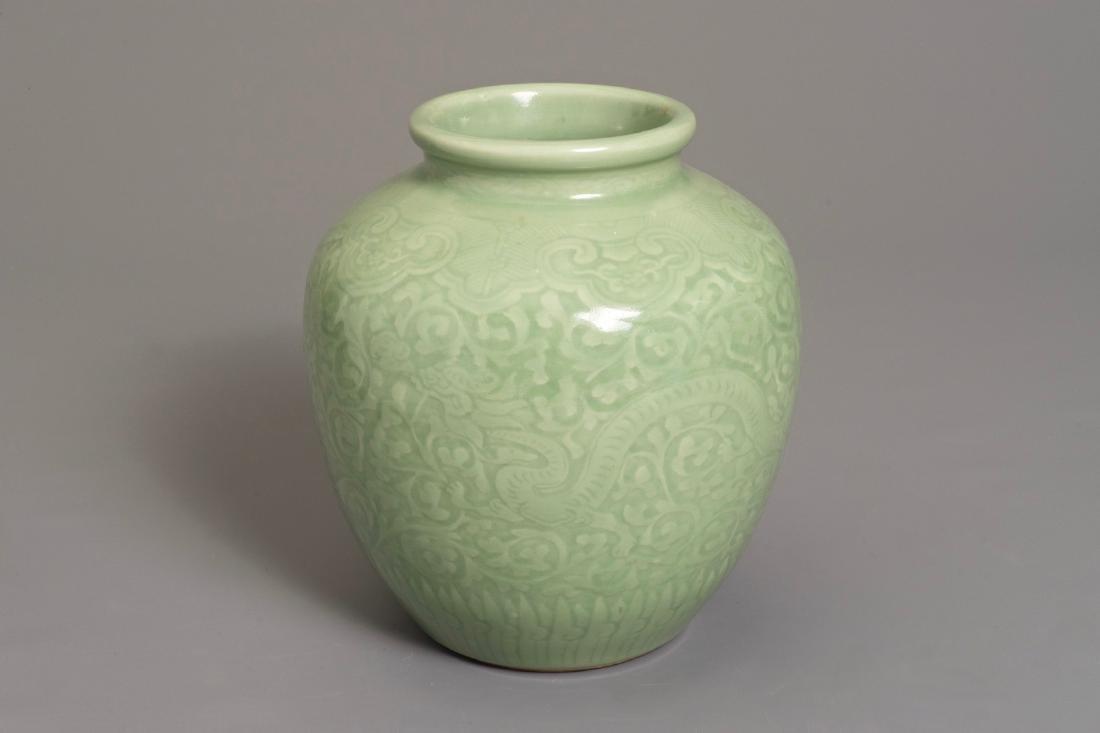 A Chinese celadon-glazed vase with underglaze dragon