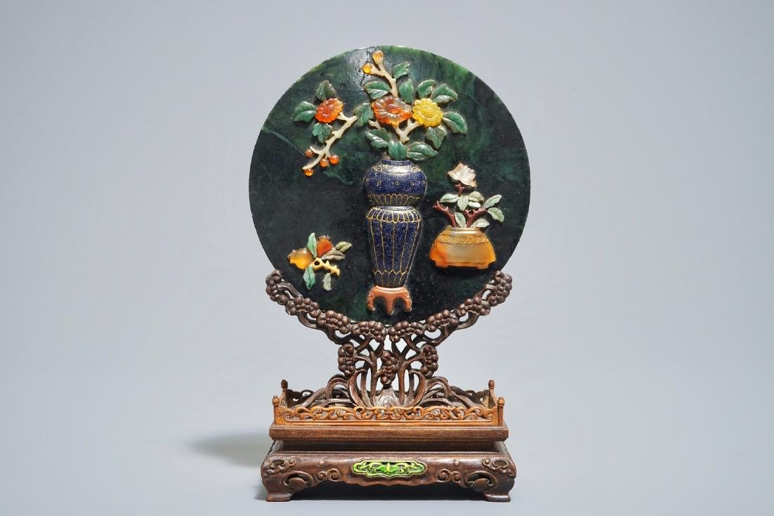 A Chinese spinach jade and hardstone inlaid screen on