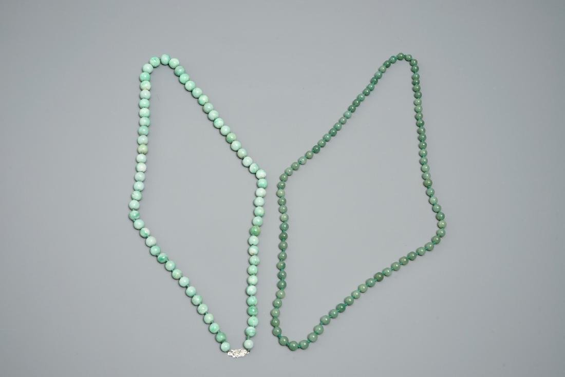 Two Chinese green jade beads necklaces, one with silver