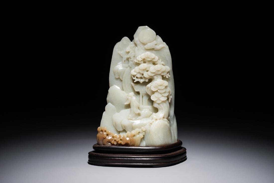A Chinese jade carving of a mountain landscape, 20th C.