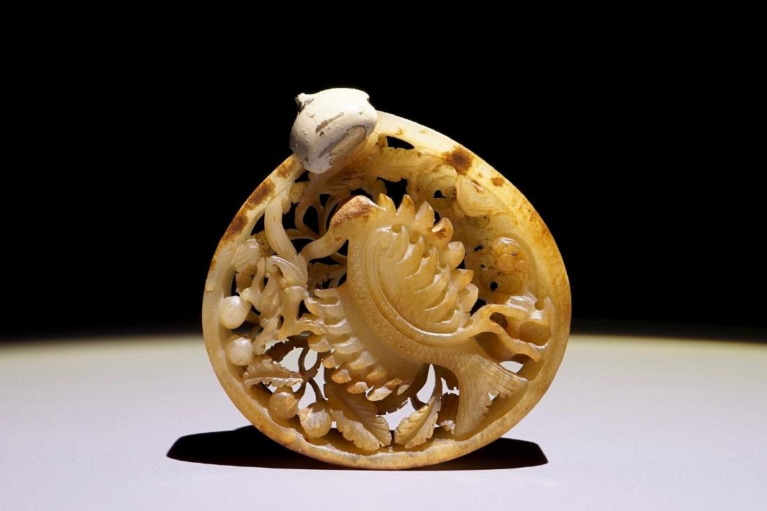 A Chinese reticulated mottled jade phoenix plaque, Ming