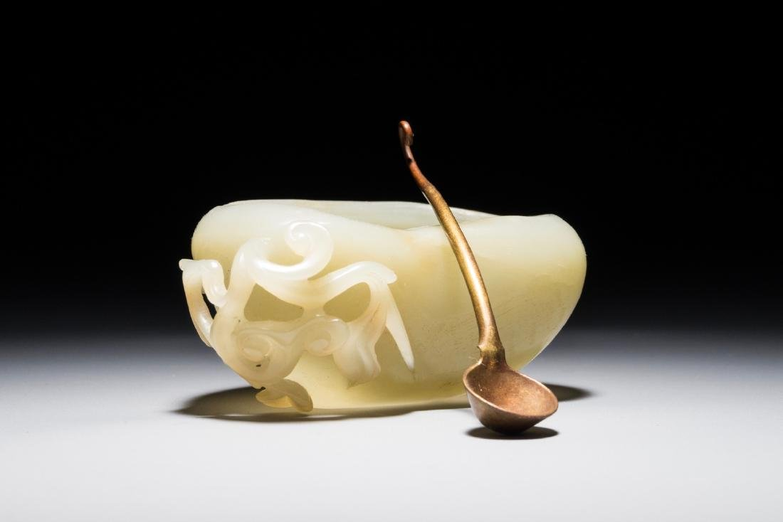 A Chinese jade calligraphy water jar with spoon,
