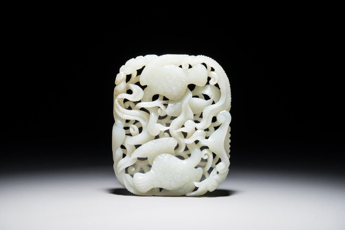 A Chinese reticulated jade plaque with geese and lotus