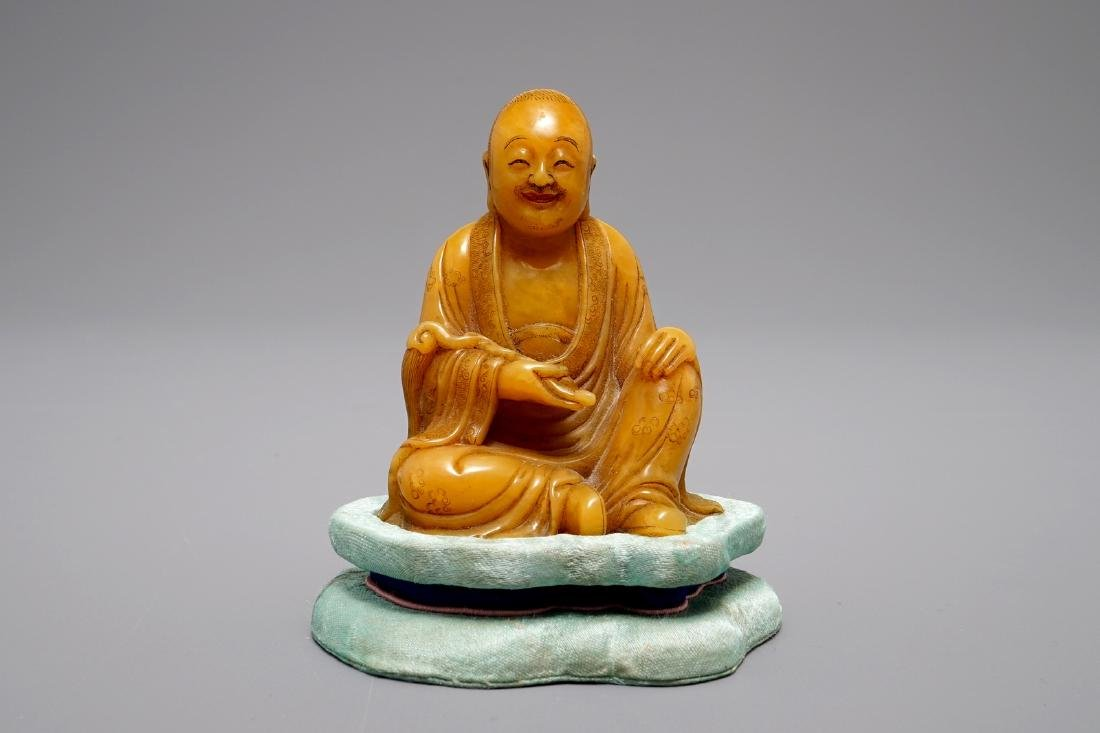 A Chinese Shoushan soapstone carving of a Luohan,