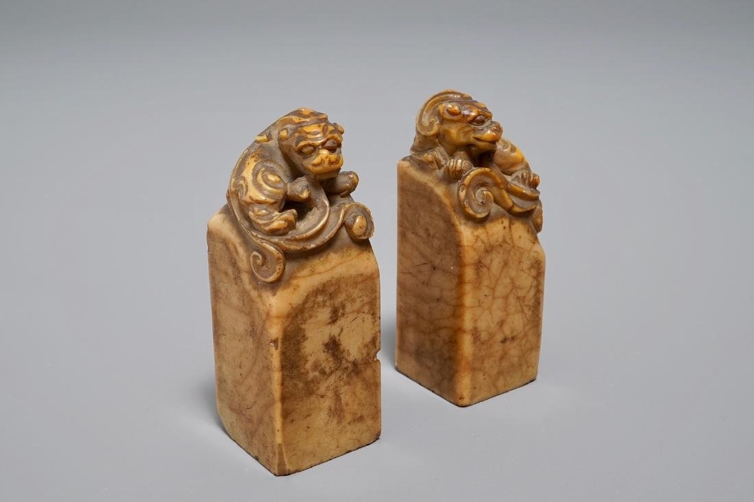 Two Chinese Shoushan stone seals with Buddhist lions,