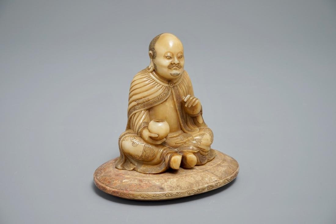 A Chinese carved Shoushan soapstone figure on inscribed