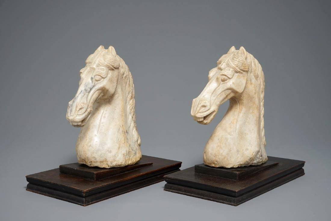A pair of Chinese carved marble horse heads, poss. Tang