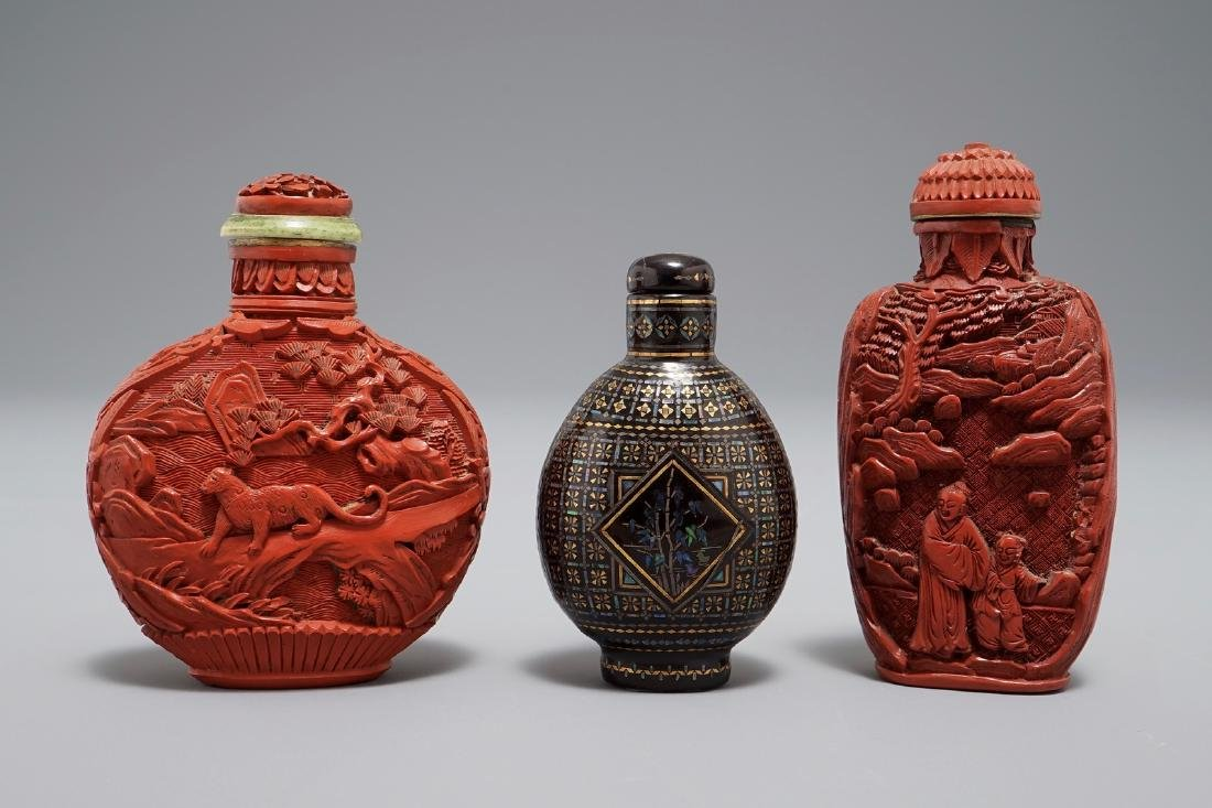 Two Chinese cinnabar lacquer snuff bottles and a