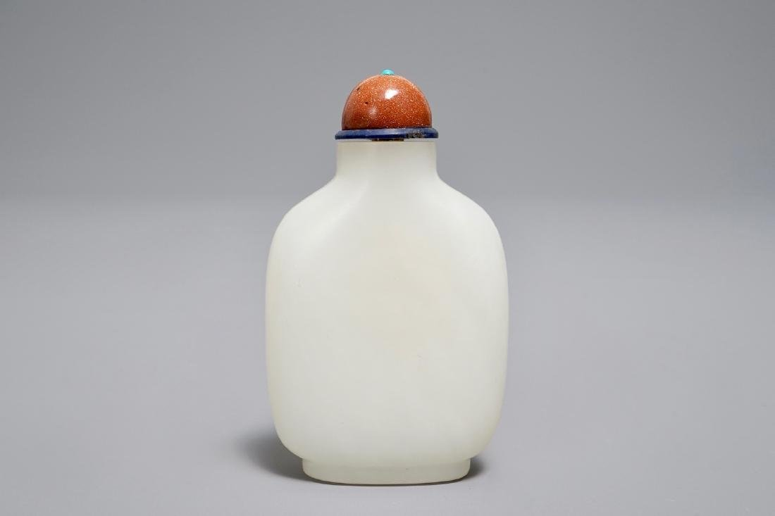 A Chinese white jade snuff bottle with goldstone