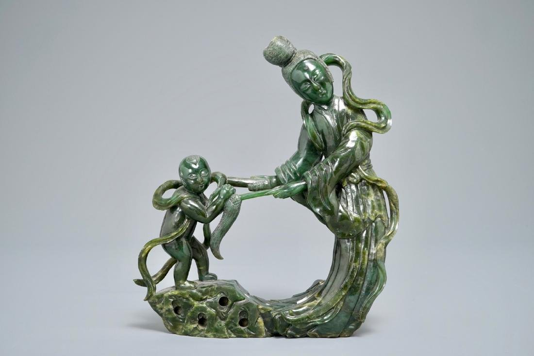A Chinese spinach green jade group of Guanyin with a