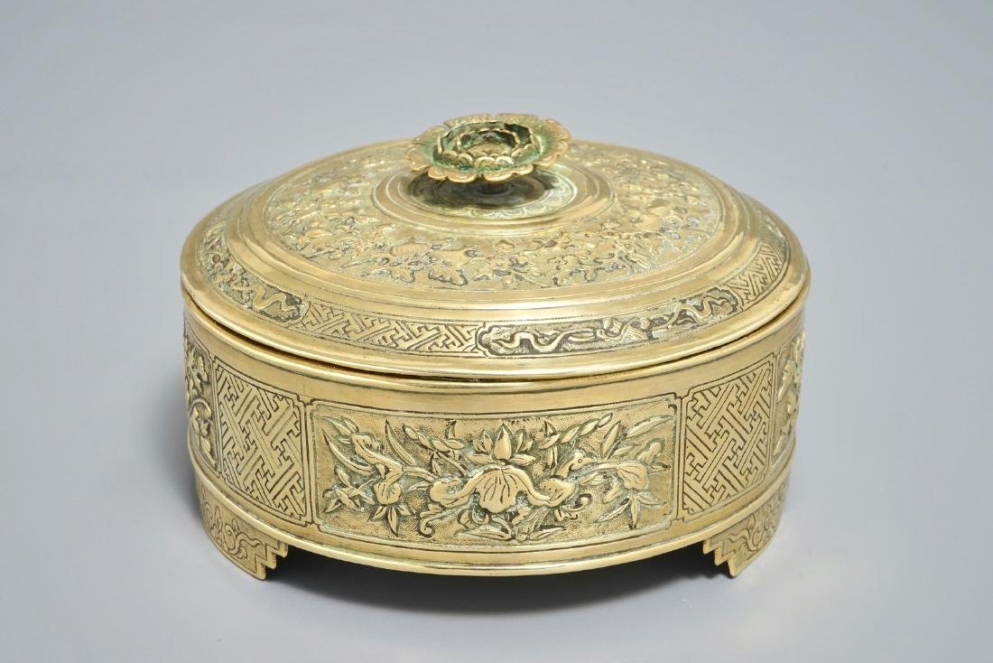 A round Chinese gilt copper-alloy box and cover with