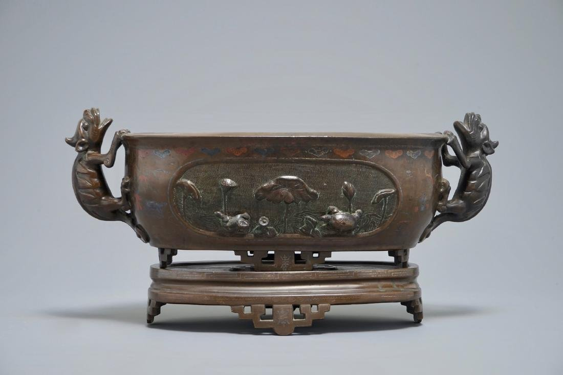 A Chinese silver-inlaid bronze jardinire on stand,