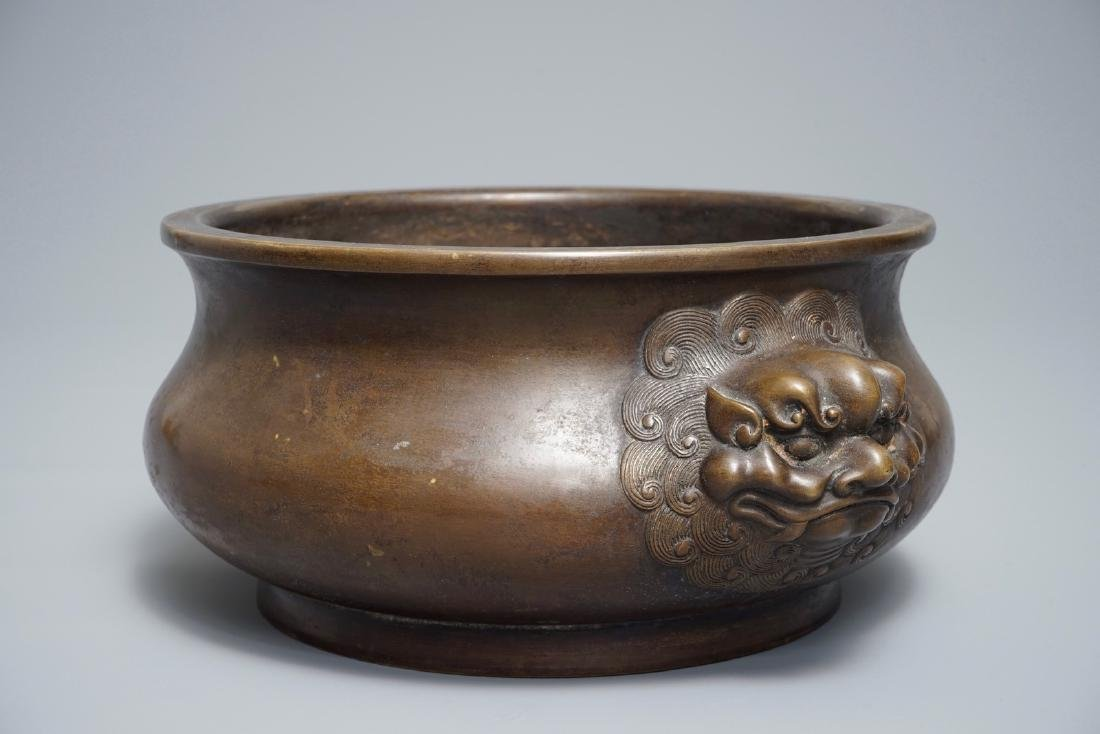 A Chinese bronze censer with lion heads, Xuande mark,