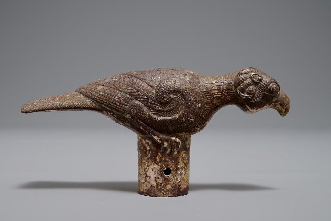 A Chinese bronze cane handle in the shape of a