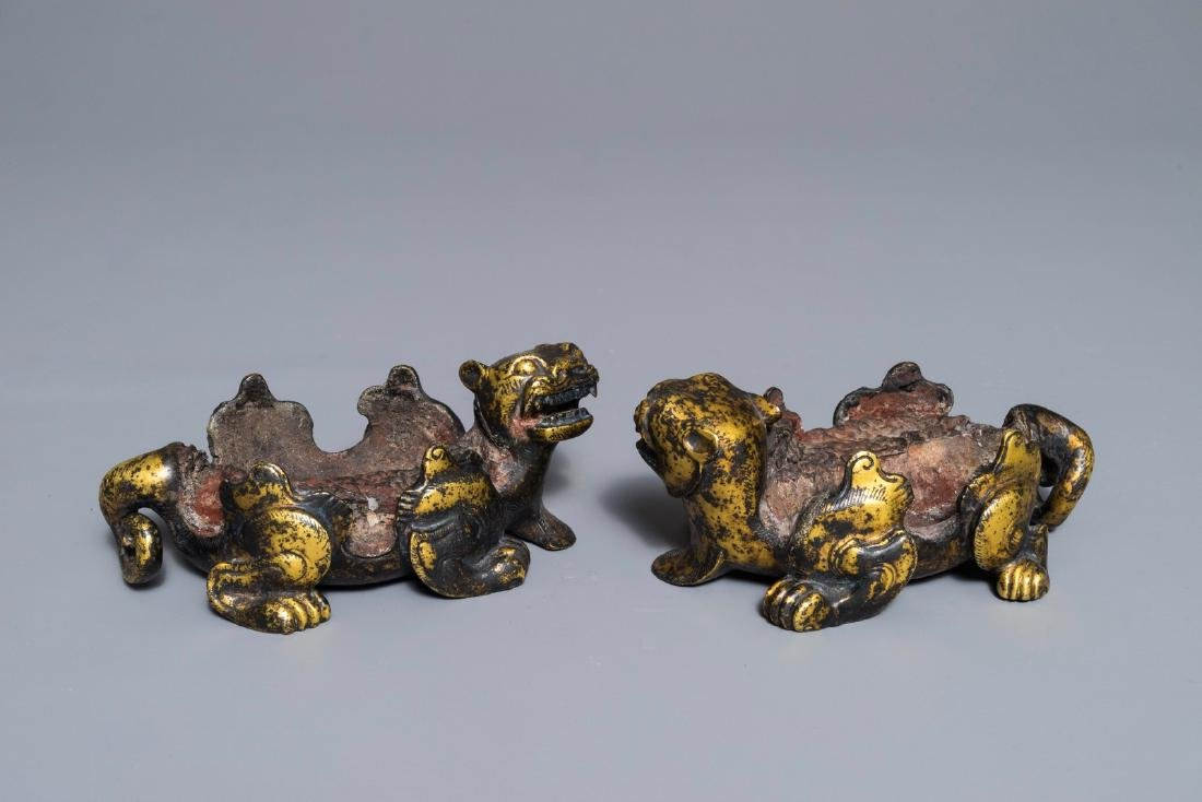 A pair of Chinese gilt bronze mythical beasts with