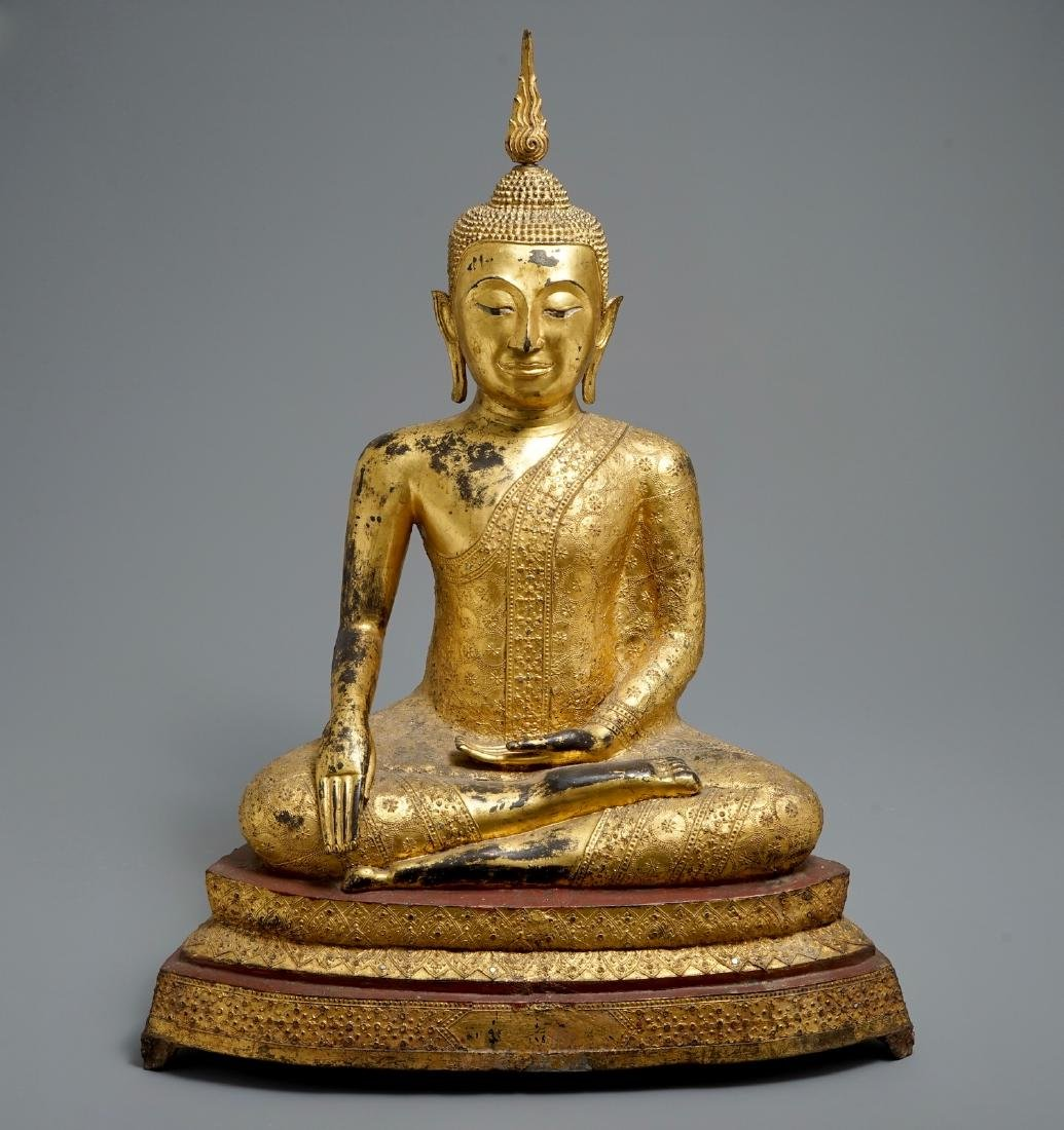 A large Thai gilt bronze Buddha seated on a lotus