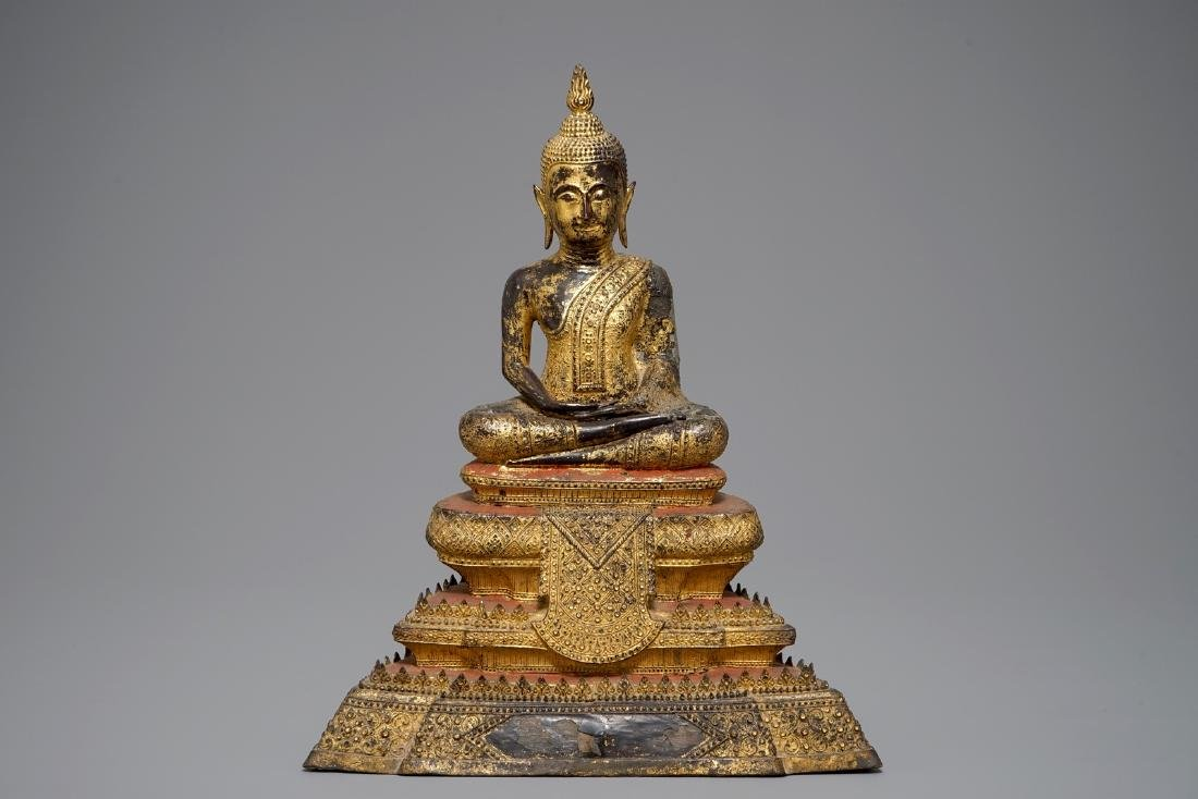 A Thai gilt bronze model of Buddha on a throne,