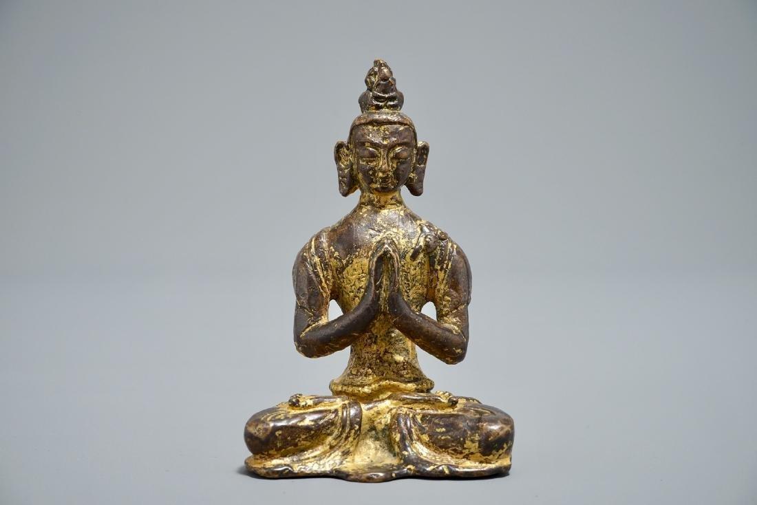 A Nepalese parcel-gilt bronze Buddha Namaskara, 16/17th