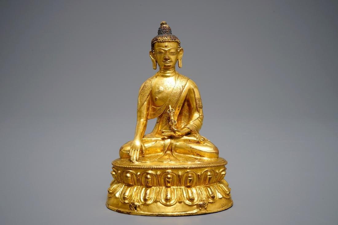 A Tibetan gilt bronze figure of Buddha with vajra, 19th