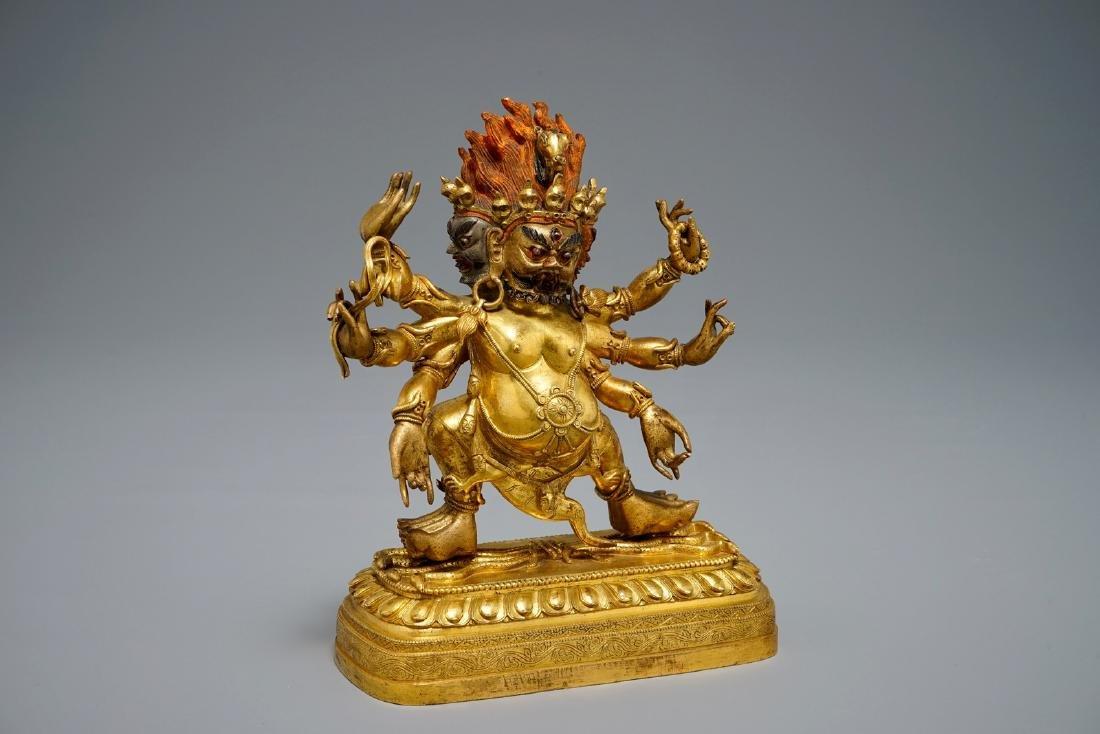 A Sino-Tibetan or Nepalese gilt bronze figure of