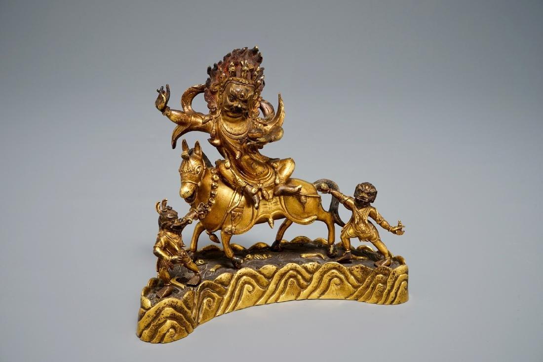 A Sino-Tibetan gilt bronze group of Palden Lhamo,