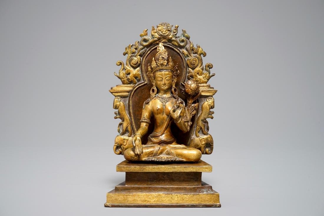 A Sino-Tibetan gilt bronze and copper alloy figure of