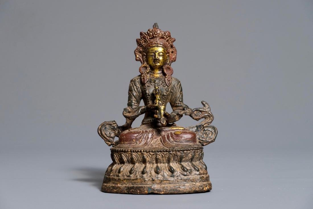 A Chinese lacquered and gilt bronze figure of Buddha