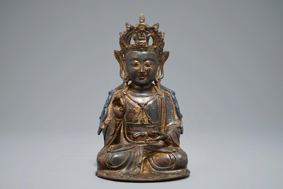 A Chinese lacquered and gilt bronze figure of Guanyin,