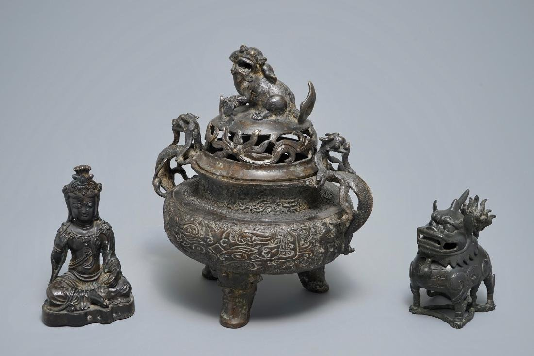 Two Chinese bronze incense burners and a figure of