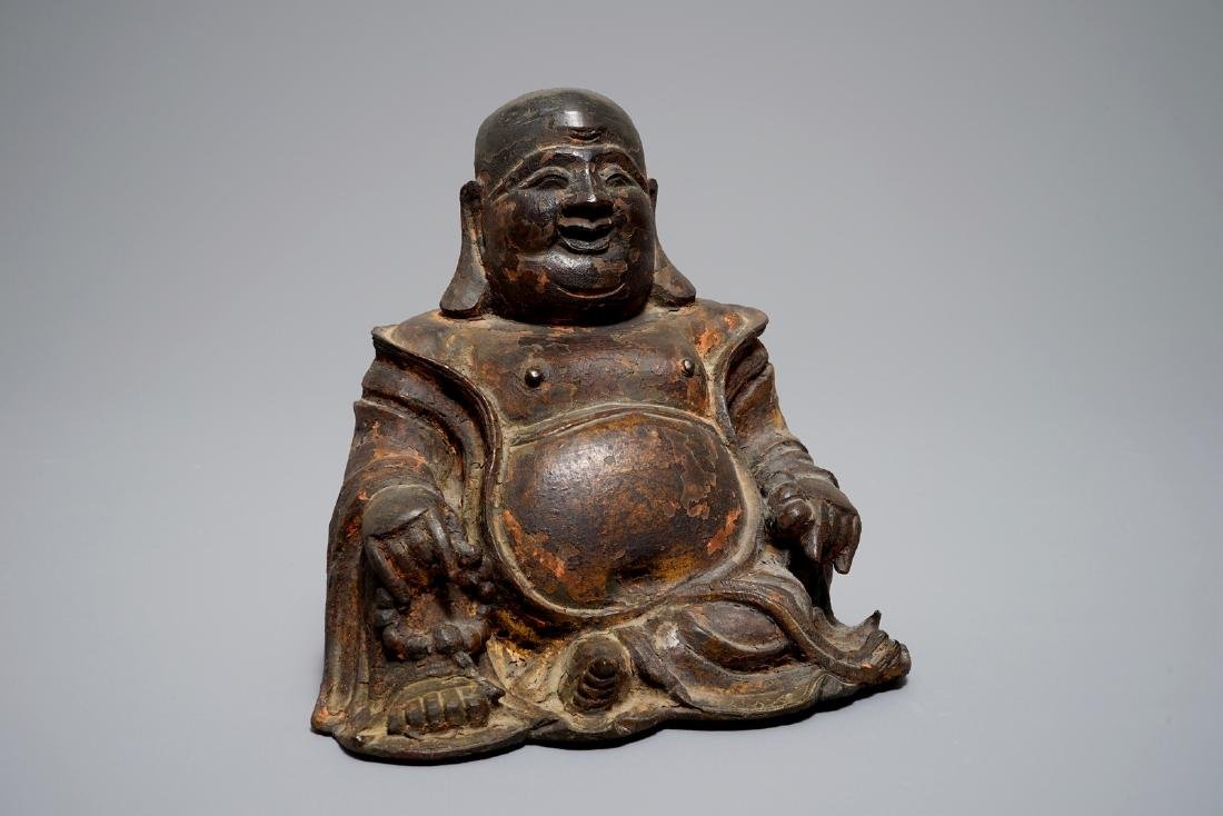 A Chinese lacquered and gilt bronze figure of Buddha,