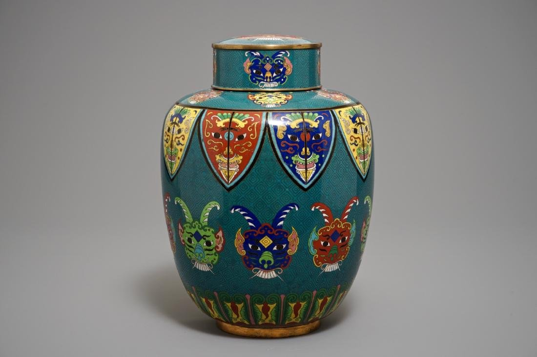 A Chinese cloisonne jar and cover with taotie masks,