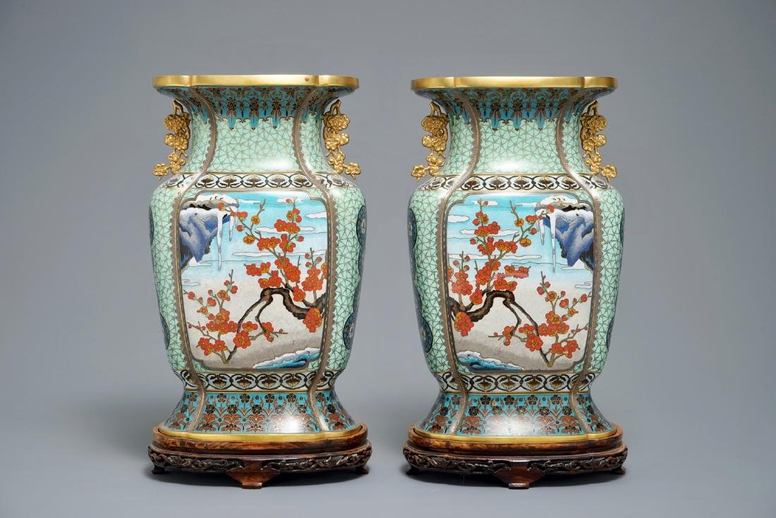A pair of Chinese parcel-gilt cloisonnŽ vases on wooden