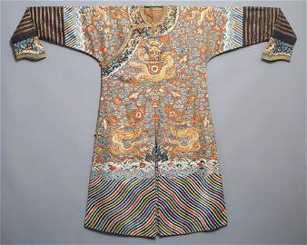 A Chinese imperial brown-ground kesi eight-dragon robe,