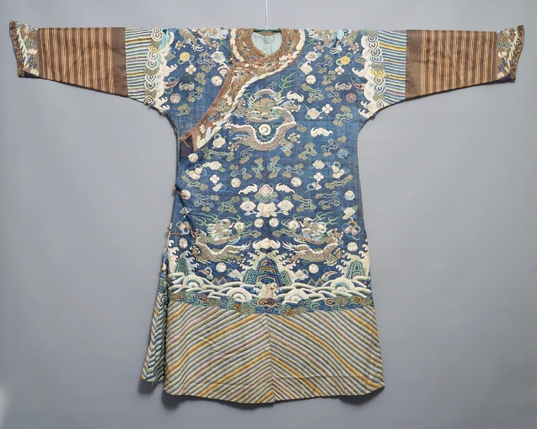 A Chinese blue-ground kesi eight-dragon robe, 19th C.