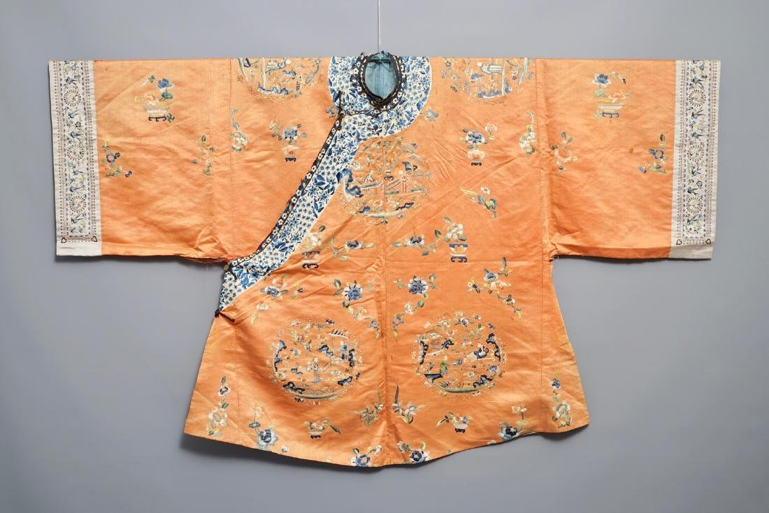 A Chinese orange-ground embroidered silk robe, 19th C.