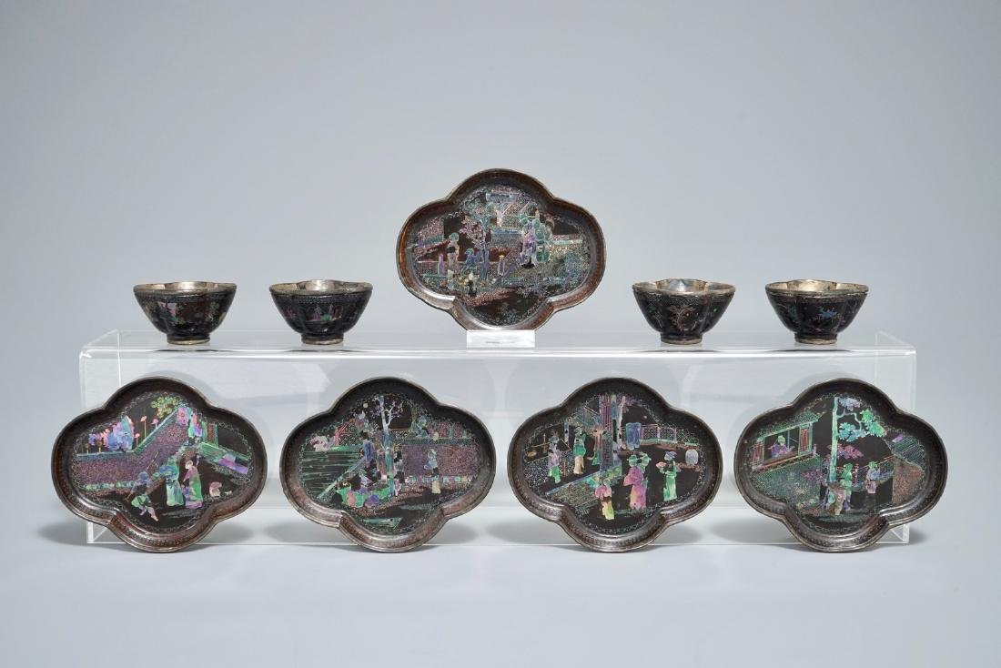 Five Chinese quatrefoil silver and lac burgaute saucers